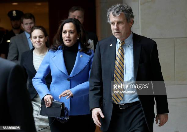 Sen Kamala Harris and Sen Sherrod Brown arrive for a military briefing for US senators on the recent US attack in Syria April 7 2017 in Washington DC...