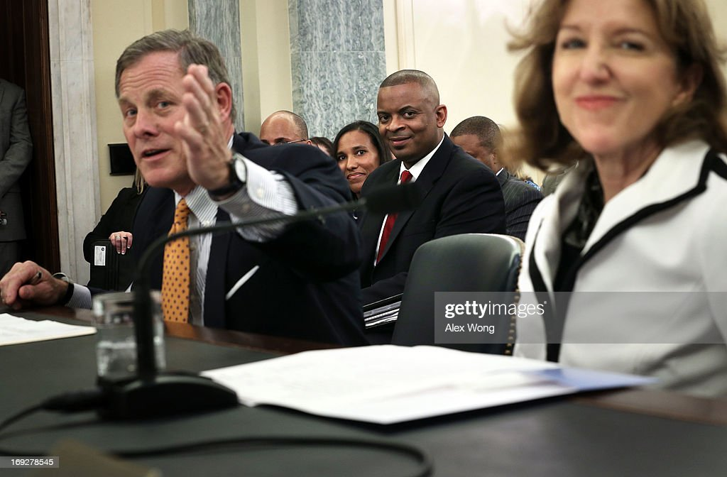 U.S. Sen. Kay Hagan (D-NC) (R) and Sen. Richard Burr (R-NC) (L) introduce Charlotte Mayor Anthony Foxx (C)) as Foxx's wife Samara (rear) looks on during a confirmation hearing before the Senate Commerce, Science and Transportation Committee May 22, 2013 on Capitol Hill in Washington, DC. Foxx will succeed Ray LaHood to become the next U.S. Secretary of Transportation if confirmed.
