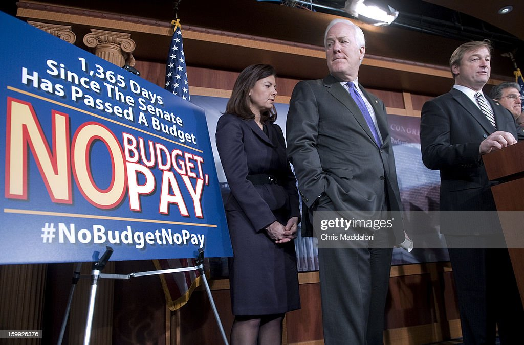 Sen. Kelly Ayotte, R-N.H.; Sen. John Cornyn, R-Tex.; Sen. Dean Heller, R-Nev.; and Sen. Joe Manchin, D-W.V., speak at a press conference on the 'No Budget, No Pay' bill. It would prevent lawmakers from receiving their salary if they do not pass a budget.