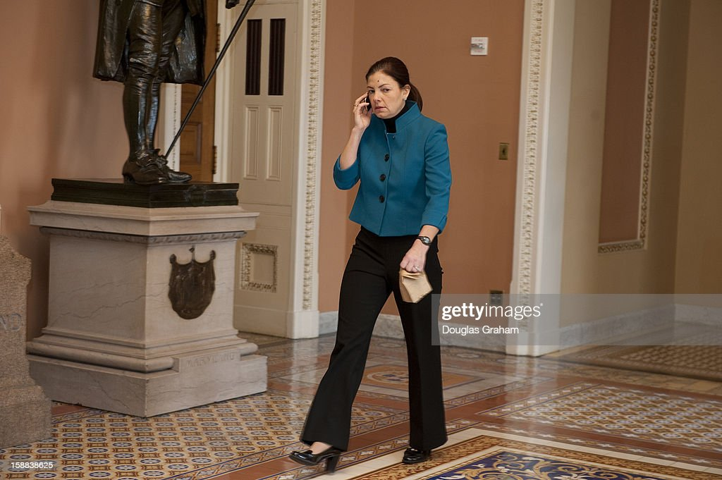 Sen. Kelly Ayotte, R-NH., talks on her cell phone as she carries a bag lunch in the U.S. Capitol on December 31, 2012 in Washington, DC. The House and Senate are both still in session on New Year's Eve to try to deal with the looming 'fiscal cliff.'