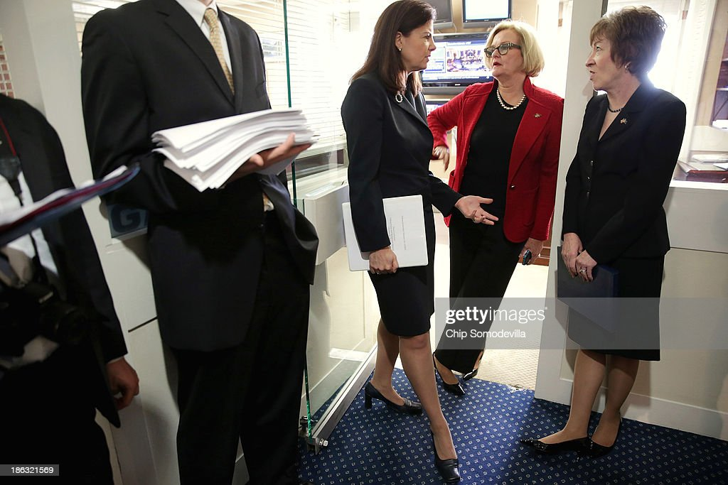 Sen Kelly Ayotte Sen Claire McCaskill and Sen Susan Collins talk before a news conference at the US Capitol October 30 2013 in Washington DC The...