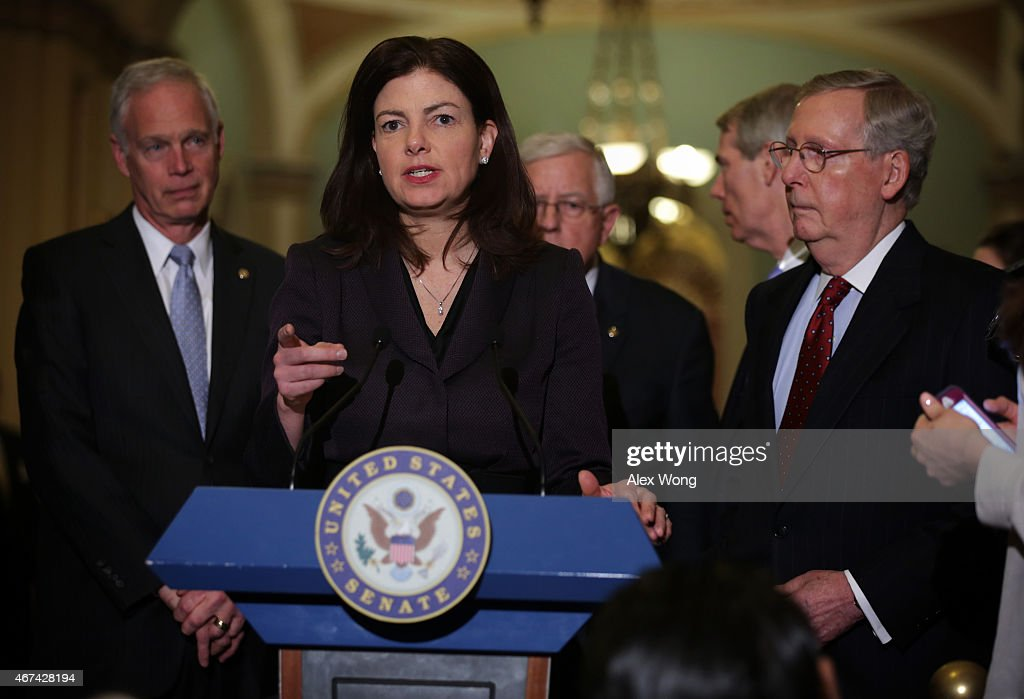 U.S. Sen. Kelly Ayotte (R-NH) (2nd L) speaks to members of the media as Sen. Ron Johnson (R-WI) (L), Sen. Michael Enzi (R-WY) (3rd L), Sen. Rob Portman (R-OH), and Senate Majority Leader Sen. Mitch McConnell (R-KY) (R) listen after the weekly Republican Policy Luncheon March 24, 2015 at the U.S. Capitol in Washington, DC. Senate Republicans held the luncheon to discuss GOP agenda.