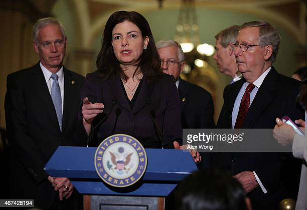 S Sen Kelly Ayotte speaks to members of the media as Sen Ron Johnson Sen Michael Enzi Sen Rob Portman and Senate Majority Leader Sen Mitch McConnell...
