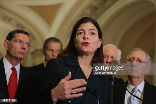 Sen Kelly Ayotte talks to reporters after the weekly Republican policy luncheon with Senate GOP leaders at the US Capitol November 10 2015 in...