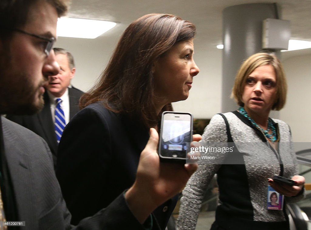 U.S. Sen. Kelly Ayotte (R-NH) (C) walks to the Senate chamber for the cloture vote on unemployment insurance at the U.S. Capitol January 7, 2014 in Washington, DC. The U.S. Senate voted 60-37 to move forward with a bill to extend federal unemployment benefits for three months.