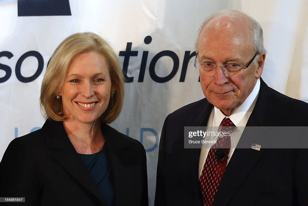 U.S. Sen. <a gi-track='captionPersonalityLinkClicked' href=/galleries/search?phrase=Kirsten+Gillibrand&family=editorial&specificpeople=4099377 ng-click='$event.stopPropagation()'>Kirsten Gillibrand</a> (D-NY) (L) and former Vice President <a gi-track='captionPersonalityLinkClicked' href=/galleries/search?phrase=Dick+Cheney&family=editorial&specificpeople=125149 ng-click='$event.stopPropagation()'>Dick Cheney</a> pose for photographs following Cheney's appearance at the Long Island Association fall luncheon at the Crest Hollow Country Club on October 18, 2012 in Woodbury, New York. Cheney discussed foreign and domestic issues, including the upcoming presidential election, at the business organization's luncheon.