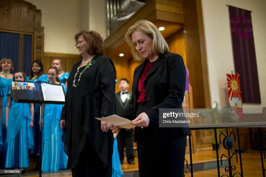 Sen. Kirsten Gillibrand, D-N.Y., (Center) prepares to speak at a Moms Rising rally for 'common sense gun laws' at the Lutheran Church of the Reformation near the U.S. Capitol.