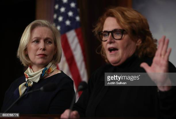 S Sen Kirsten Gillibrand looks on as Sen Heidi Heitkamp speaks during a news conference at the US Capitol on March 14 2017 in Washington DC Senate...