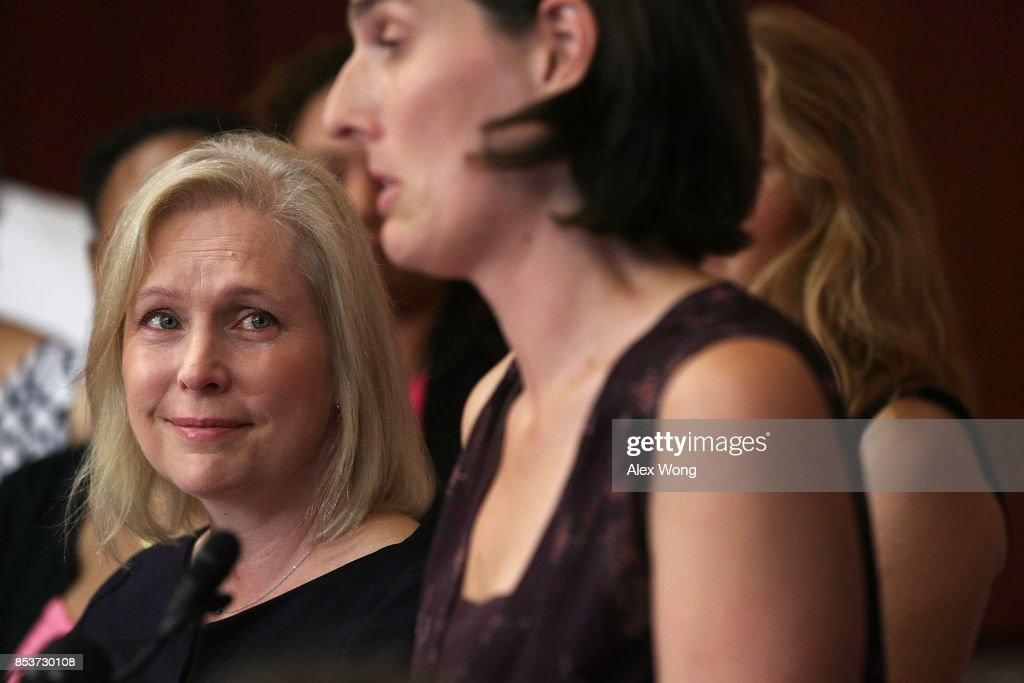 U.S. Sen. Kirsten Gillibrand (D-NY) (L) tears up as she listens to a patient's story during a news conference on health care September 25, 2017 on Capitol Hill in Washington, DC. Activists gathered to urge to reject the Graham-Cassidy health care bill.
