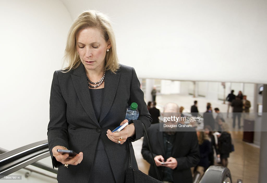 Sen. Kristen Gillibrand, D-NY., checks her phone as she walks to the Senate luncheons through the subway in the U.S. Capitol on November 5, 2013.