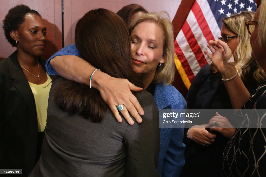 Sen. Kristen Gillibrand (D-NY) embraces End Rape on Campus co-founder Andrea Pino, a survivor of sexual assult at the University of North Carolina, during a news conference about new legislation aimed at curbing sexual assults on college and university campuses at the U.S. Capitol Visitors Center July 30, 2014 in Washington, DC. With strong bipartisan support in the Senate, the bill would require schools to make public the result of anonymous surveys about campus assaults and impose significant financial burdens on universities that fail to comply with some of the lawÕs requirements.