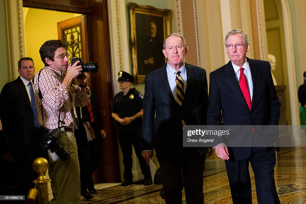 Sen. <a gi-track='captionPersonalityLinkClicked' href=/galleries/search?phrase=Lamar+Alexander&family=editorial&specificpeople=211236 ng-click='$event.stopPropagation()'>Lamar Alexander</a> (R-TN) and Senate Minority Leader <a gi-track='captionPersonalityLinkClicked' href=/galleries/search?phrase=Mitch+McConnell&family=editorial&specificpeople=217985 ng-click='$event.stopPropagation()'>Mitch McConnell</a> (R-KY) leave the Senate floor and head to a news conference on Capitol Hill, November 21, 2013 in Washington, DC. The Senate voted 52-48 to invoke the so-called 'nuclear option', voting to change Senate rules on the controversial filibuster for most presidential nominations with a simple majority vote.