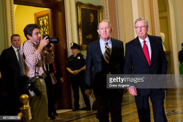 Sen Lamar Alexander and Senate Minority Leader Mitch McConnell leave the Senate floor and head to a news conference on Capitol Hill November 21 2013...