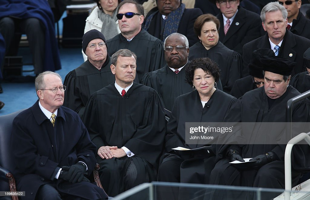 U.S. Sen. <a gi-track='captionPersonalityLinkClicked' href=/galleries/search?phrase=Lamar+Alexander&family=editorial&specificpeople=211236 ng-click='$event.stopPropagation()'>Lamar Alexander</a> (R-TN) and Supreme Court Chief Justices <a gi-track='captionPersonalityLinkClicked' href=/galleries/search?phrase=Anthony+Kennedy&family=editorial&specificpeople=220874 ng-click='$event.stopPropagation()'>Anthony Kennedy</a>, John Roberts, <a gi-track='captionPersonalityLinkClicked' href=/galleries/search?phrase=Samuel+Alito&family=editorial&specificpeople=274708 ng-click='$event.stopPropagation()'>Samuel Alito</a>, <a gi-track='captionPersonalityLinkClicked' href=/galleries/search?phrase=Clarence+Thomas&family=editorial&specificpeople=217528 ng-click='$event.stopPropagation()'>Clarence Thomas</a>, <a gi-track='captionPersonalityLinkClicked' href=/galleries/search?phrase=Sonia+Sotomayor&family=editorial&specificpeople=5872777 ng-click='$event.stopPropagation()'>Sonia Sotomayor</a>, <a gi-track='captionPersonalityLinkClicked' href=/galleries/search?phrase=Elena+Kagan&family=editorial&specificpeople=5704239 ng-click='$event.stopPropagation()'>Elena Kagan</a> and <a gi-track='captionPersonalityLinkClicked' href=/galleries/search?phrase=Antonin+Scalia&family=editorial&specificpeople=215620 ng-click='$event.stopPropagation()'>Antonin Scalia</a> look on during the public ceremonial inauguration for U.S. President Barack Obama on the West Front of the U.S. Capitol January 21, 2013 in Washington, DC. Barack Obama was re-elected for a second term as President of the United States.