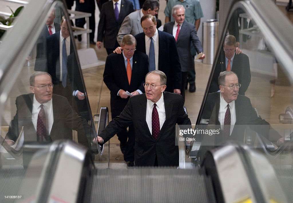 Sen. Lamar Alexander, R-Tenn., followed by Sens. Johnny Isakson, Richard Shelby, Joe Manchin and Bob Corker, arrive in the Capitol for votes on the highway bill on Wednesday, March 14, 2012.