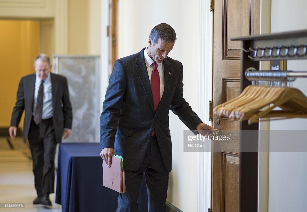 Sen. Lamar Alexander, R-Tenn., left, and Sen. John Thune, R-S. Dak., leave the Senate Republicans' lunch in the Capitol on Wednesday, Sept. 12, 2012.