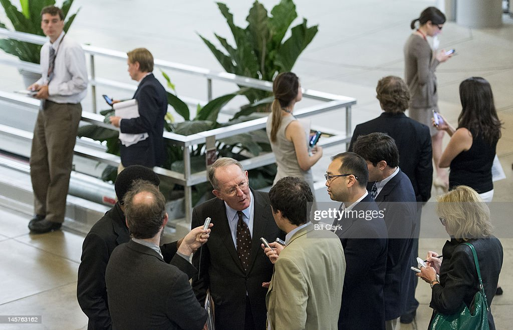 Sen. Lamar Alexander, R-Tenn., speaks with reporters as he arrives in the Capitol via the Senate subway for the weekly Senate Republicans' policy lunch on Tuesday, June 5, 2012.