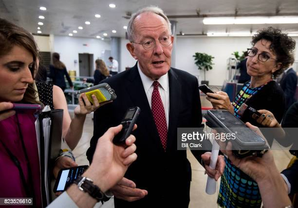 Sen Lamar Alexander RTenn speaks with reporters as he waits for the Dirksen/Hart subway in the Capitol on Thursday July 27 2017