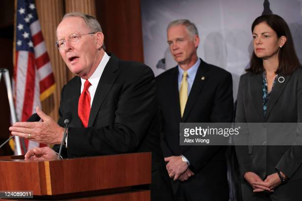US Sen Lamar Alexander speaks as Sen Ron Johnson and Sen Kelly Ayotte listen during a news conference September 8 2011 on Capitol Hill in Washington...