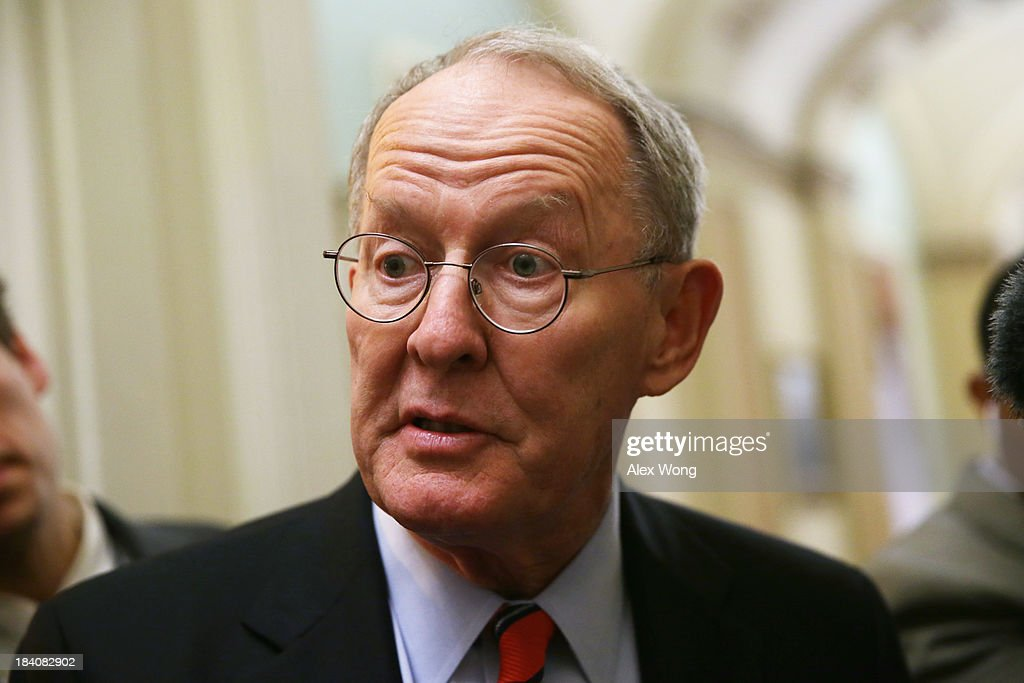 U.S. Sen. <a gi-track='captionPersonalityLinkClicked' href=/galleries/search?phrase=Lamar+Alexander&family=editorial&specificpeople=211236 ng-click='$event.stopPropagation()'>Lamar Alexander</a> (R-TN) speaks to members of the media at the Capitol October 11, 2013 on Capitol Hill in Washington, DC. On the 11th day of a U.S. Government shutdown, President Barack Obama spoke with Speaker Boehner on the phone and they agreed that they should keep talking.