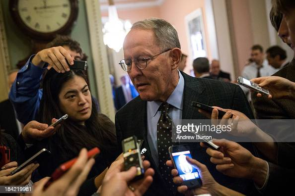 Sen Lamar Alexander speaks to reporters before going into the Senate Chamber to vote on October 12 2013 in Washington DC The shut down is currently...