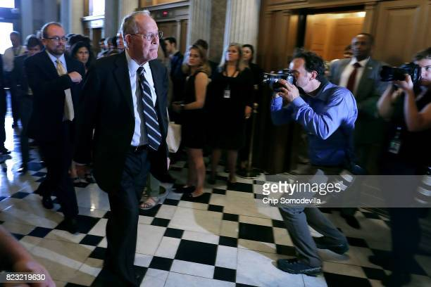 Sen Lamar Alexander walks to the Senate Chamber for a vote in the US Capitol July 26 2017 in Washington DC GOP efforts to pass legislation to repeal...