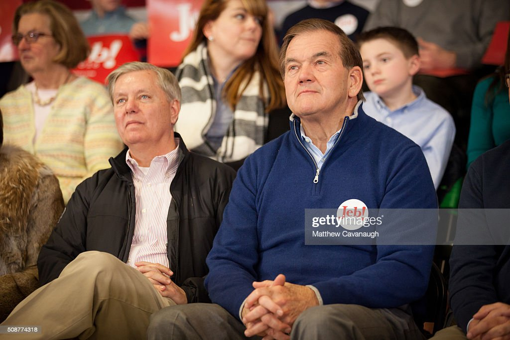 Sen. <a gi-track='captionPersonalityLinkClicked' href=/galleries/search?phrase=Lindsey+Graham&family=editorial&specificpeople=240214 ng-click='$event.stopPropagation()'>Lindsey Graham</a> (R-SC) (L) and former Homeland Security secretary <a gi-track='captionPersonalityLinkClicked' href=/galleries/search?phrase=Tom+Ridge&family=editorial&specificpeople=138617 ng-click='$event.stopPropagation()'>Tom Ridge</a> listen as republican presidential candidate Jeb Bush speaks at a town hall style meeting on February 6, 2016 at the McKelvie Intermediate School in Bedford, New Hampshire. Bush is campaigning in the lead up to the The New Hampshire primary, February 9.