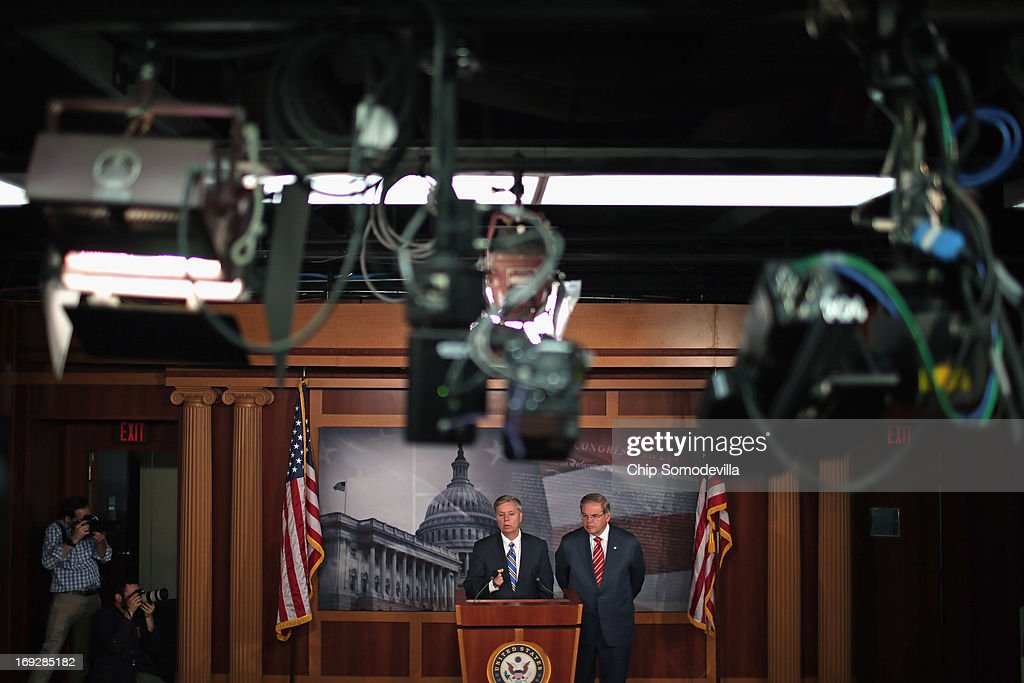 U.S. Sen. Lindsey Graham (R-SC) (L) and U.S. Senate Foreign Relations Committee Chairman Robert Menendez (D-NJ) hold a news conference after the senate voted 99-0 in favor of their resolution in support of Israel May 22, 2013 in Washington, DC. The resolution 'expresses concerns about the Iranian nuclear threat and urges that if Israel is compelled to take action in self-defense, the United States will stand with Israel and provide diplomatic, military, and economic support in its defense of its territory, people, and existence.'
