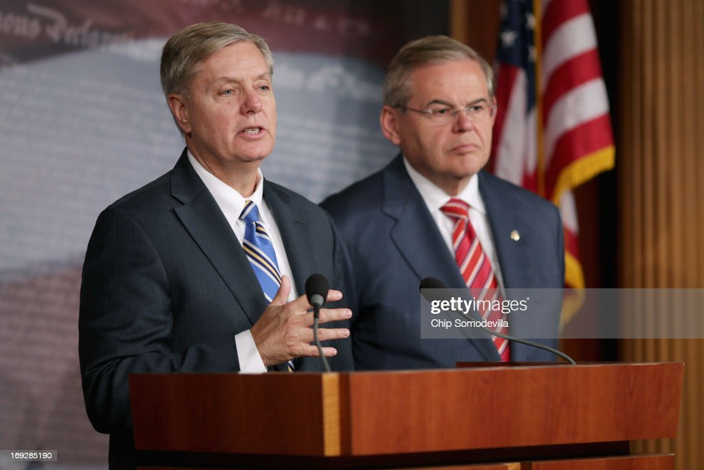 U.S. Sen. <a gi-track='captionPersonalityLinkClicked' href=/galleries/search?phrase=Lindsey+Graham&family=editorial&specificpeople=240214 ng-click='$event.stopPropagation()'>Lindsey Graham</a> (R-SC) (L) and U.S. Senate Foreign Relations Committee Chairman <a gi-track='captionPersonalityLinkClicked' href=/galleries/search?phrase=Robert+Menendez&family=editorial&specificpeople=504931 ng-click='$event.stopPropagation()'>Robert Menendez</a> (D-NJ) hold a news conference after the senate voted 99-0 in favor of their resolution in support of Israel May 22, 2013 in Washington, DC. The resolution 'expresses concerns about the Iranian nuclear threat and urges that if Israel is compelled to take action in self-defense, the United States will stand with Israel and provide diplomatic, military, and economic support in its defense of its territory, people, and existence.'