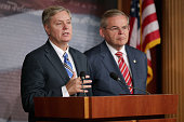 S Sen Lindsey Graham and US Senate Foreign Relations Committee Chairman Robert Menendez hold a news conference after the senate voted 990 in favor of...