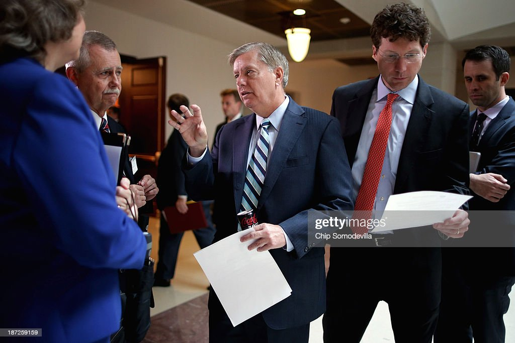 Sen. Lindsey Graham (R-SC) (C) arrives at a news conference to introduce new legislation, the Pain-Capable Unborn Child Protection Act, at the U.S. Capitol November 7, 2013 in Washington, DC. Graham, who is seeking a third term in the Senate in 2014, is facing a primary challenge from Tea Party-backed candidate Nancy Mace. After Graham criticized a filibuster against the Obama administration's drone program by Sen. Rand Paul (R-KY), FreedomWorks president Matt Kibbe said Graham is 'begging for a primary' fight.