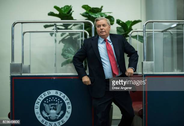 Sen Lindsey Graham gets off the Senate subway on his way to an amendment vote on the GOP heath care legislation on Capitol Hill July 27 2017 in...
