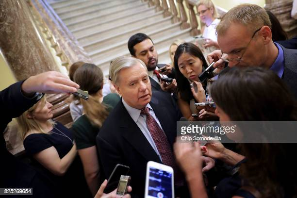 Sen Lindsey Graham is surrounded by reporters before attending the Senate Republican policy luncheon at the US Capitol August 1 2017 in Washington DC...