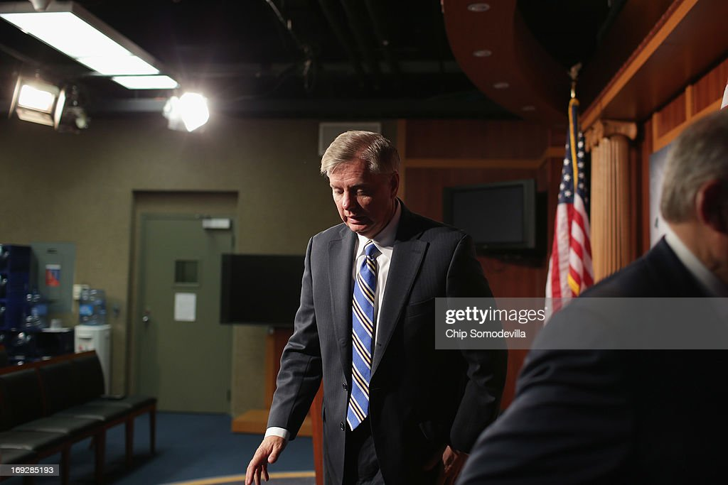 U.S. Sen. <a gi-track='captionPersonalityLinkClicked' href=/galleries/search?phrase=Lindsey+Graham&family=editorial&specificpeople=240214 ng-click='$event.stopPropagation()'>Lindsey Graham</a> (R-SC) leaves after a news conference after the senate voted 99-0 in favor of a resolution in support of Israel May 22, 2013 in Washington, DC. The resolution 'expresses concerns about the Iranian nuclear threat and urges that if Israel is compelled to take action in self-defense, the United States will stand with Israel and provide diplomatic, military, and economic support in its defense of its territory, people, and existence.'