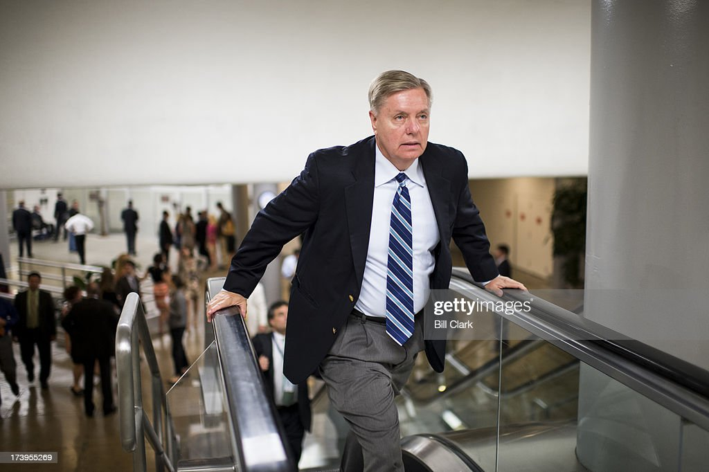 Sen. Lindsey Graham, R-S.C., runs up the escalator from the Senate subway to the Capitol for a vote on Thursday, July 18, 2013.
