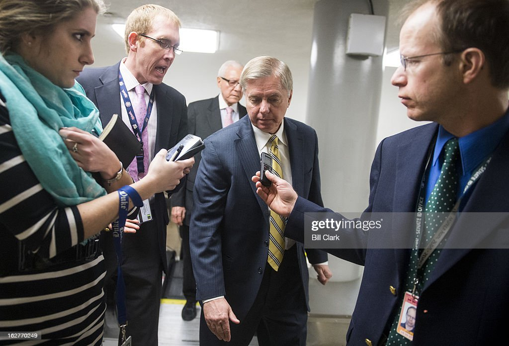 Sen. Lindsey Graham, R-S.C., speaks with reporters as he makes his way to the Senate floor for the cloture vote on Chuck Hagel's nomination to be Secretary of Defense on Tuesday, Feb. 26, 2013.