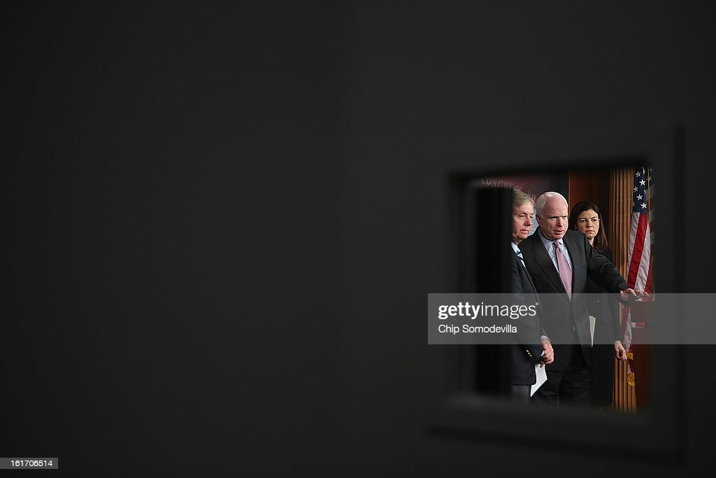 Sen. <a gi-track='captionPersonalityLinkClicked' href=/galleries/search?phrase=Lindsey+Graham&family=editorial&specificpeople=240214 ng-click='$event.stopPropagation()'>Lindsey Graham</a> (R-SC), Sen. <a gi-track='captionPersonalityLinkClicked' href=/galleries/search?phrase=John+McCain&family=editorial&specificpeople=125177 ng-click='$event.stopPropagation()'>John McCain</a> (R-AZ) and Sen. <a gi-track='captionPersonalityLinkClicked' href=/galleries/search?phrase=Kelly+Ayotte&family=editorial&specificpeople=6986995 ng-click='$event.stopPropagation()'>Kelly Ayotte</a> (R-NH) hold a news conference at the U.S. Capitol February 14, 2013 in Washington, DC. The GOP senators are working to delay the confirmation vote on former Sen. Chuck Hagel (R-NE) to be the next secretary of defense until they get more information from the Obama Administration about last fall's attack on the U.S. consulate in Libya.