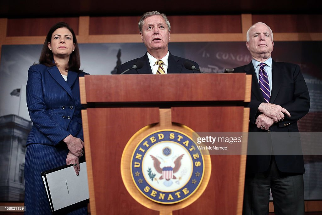 Sen. <a gi-track='captionPersonalityLinkClicked' href=/galleries/search?phrase=Lindsey+Graham&family=editorial&specificpeople=240214 ng-click='$event.stopPropagation()'>Lindsey Graham</a> (R-SC) (C), Sen. <a gi-track='captionPersonalityLinkClicked' href=/galleries/search?phrase=John+McCain&family=editorial&specificpeople=125177 ng-click='$event.stopPropagation()'>John McCain</a> (R-AZ) (R) and Sen. <a gi-track='captionPersonalityLinkClicked' href=/galleries/search?phrase=Kelly+Ayotte&family=editorial&specificpeople=6986995 ng-click='$event.stopPropagation()'>Kelly Ayotte</a> (R-NH) speak during a press conference to discuss the Accountability Review Board report into the Benghazi terrorist attack at the U.S. Capitol December 21, 2012 in Washington, DC. Graham and McCain called for Secretary of State Hillary Clinton to testify on the subject before she leaves her current position.