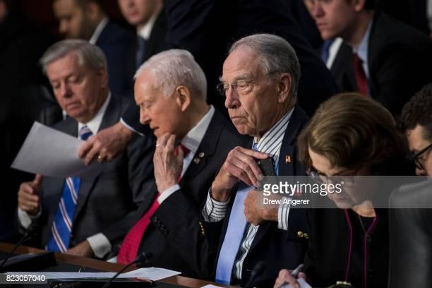 Sen Lindsey Graham Sen Orrin Hatch committee chairman Sen Chuck Grassley and ranking member Sen Dianne Feinstein listen to testimony during a Senate...