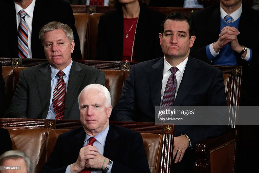 U.S. Sen. Lindsey Graham (R-SC), U.S. Sen. John McCain (R-AZ) and U.S. Sen. Ted Cruz (R-TX) listen as U.S. President Barack Obama delivers the State of the Union address to a joint session of Congress in the House Chamber at the U.S. Capitol on January 28, 2014 in Washington, DC. In his fifth State of the Union address, Obama is expected to emphasize on healthcare, economic fairness and new initiatives designed to stimulate the U.S. economy with bipartisan cooperation.