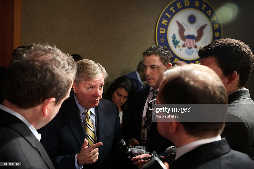 Sen. Linsey Graham (R-SC) speaks to reporters after a press conference about gun control regulation on Capitol Hill in Washington D.C., February 13, 2013. Graham cited the case of a woman named Alice Boland who was able to buy a gun, which she allegedly used to try to kill a school official, despite being previously diagnosed with paranoid schizophrenia and having faced federal charges for threatening to kill President George W. Bush.