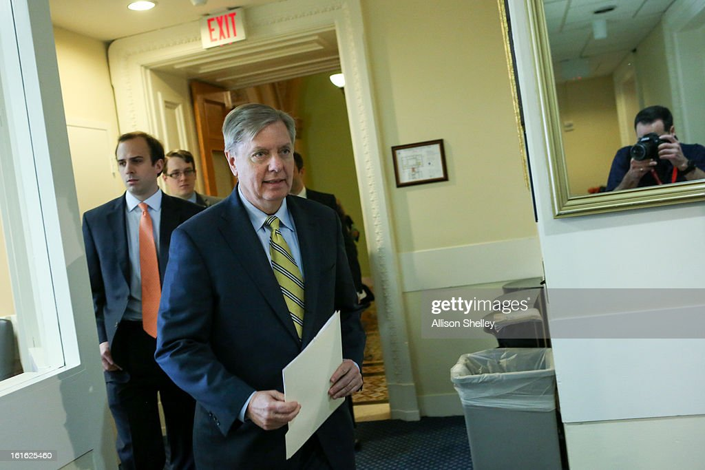 Sen. Linsey Graham (R-SC) walks into a press conference about gun control regulation on Capitol Hill in Washington D.C., February 13, 2013. Graham cited the case of a woman named Alice Boland who was able to buy a gun, which she allegedly used to try to kill a school official, despite being previously diagnosed with paranoid schizophrenia and having faced federal charges for threatening to kill President George W. Bush.