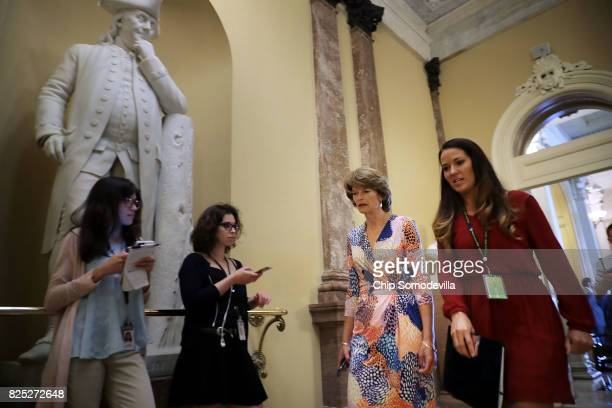 Sen Lisa Murkowski heads to the Senate Republican policy luncheon at the US Capitol August 1 2017 in Washington DC After failing to pass legislation...