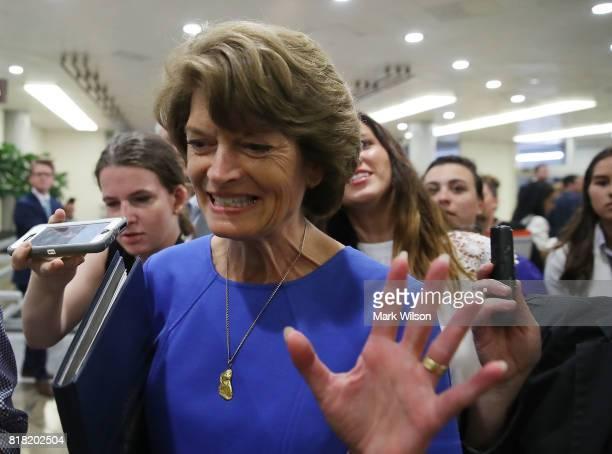 Sen Lisa Murkowski is followed by reporters as she walks through the Senate Subway inside of the US Capitol on July 18 2017 in Washington DC Sen...