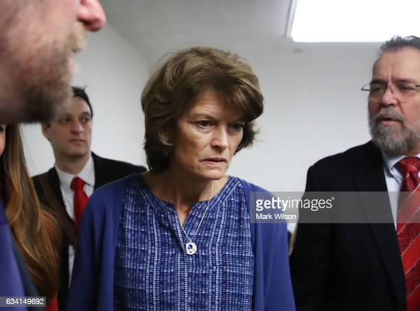 Sen Lisa Murkowski is followed by reporters while going to a vote in the Senate Chamber February 7 2017 in Washington DC Murkowski voted against the...