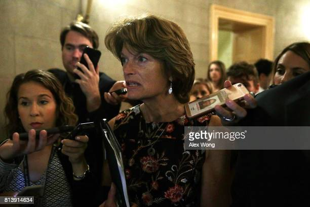S Sen Lisa Murkowski is surround by members of the media as she is on her way to view the details of a new health care bill July 13 2017 at the...
