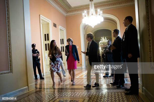 Sen Lisa Murkowski is trailed by a reporter as she makes her way to the Senate floor on Capitol Hill July 25 2017 in Washington DC The Senate voted...