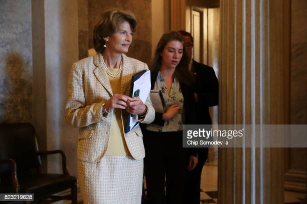 Sen Lisa Murkowski leaves the Senate Chamber following a couple of votes in the US Capitol July 26 2017 in Washington DC GOP efforts to pass...