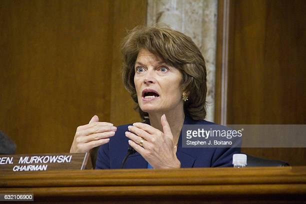 Sen Lisa Murkowski RAlaska speaks to former Texas Governor Rick Perry Presidentelect Donald Trump's choice as Secretary of Energy as he testified at...