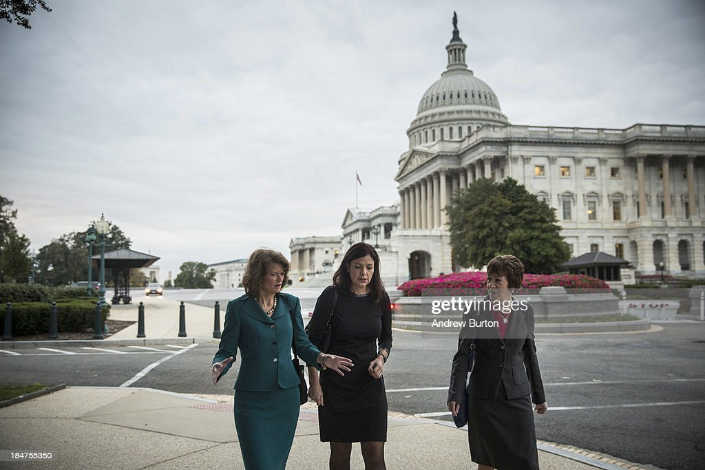 Sen Lisa Murkowski Sen Kelly Ayotte and Sen Susan Collins walk past the Capitol Building after praying with a group of religious leaders and also...